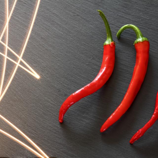 """Red chilli pepper light trails"" stock image"