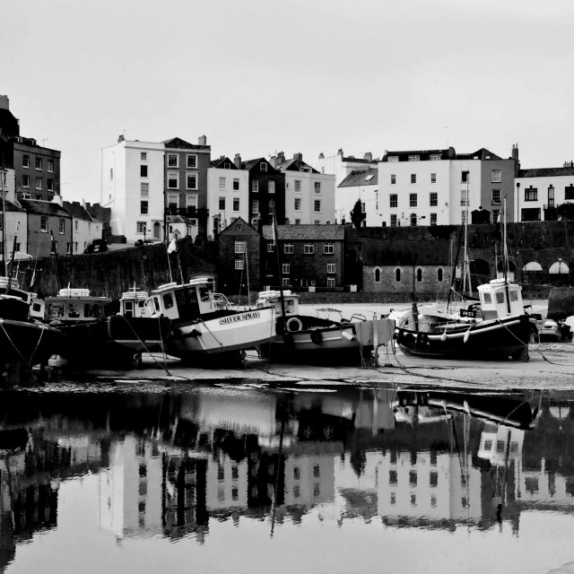 """""""Fishing boats moored at the harbour (harbor) at Tenby."""" stock image"""