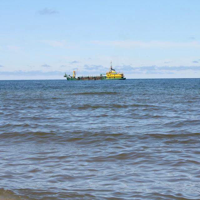 """Ship dredger at sea"" stock image"