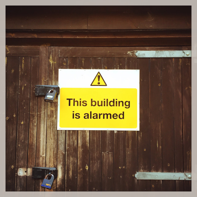 """""""The Building is Alarmed …"""" stock image"""