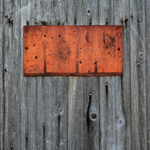 """""""Rusty metal sign on wooden wall."""" stock image"""