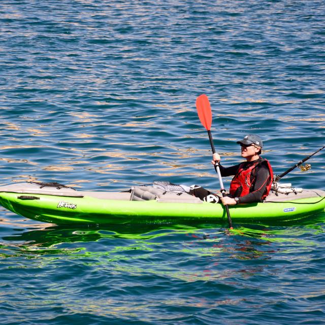 """Canoeist in the Grand harbour, Valletta, Malta"" stock image"