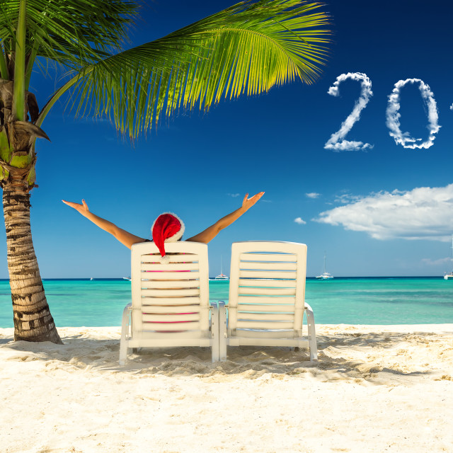 """""""2018 new year concept with woman in santa's hat relaxing on tro"""" stock image"""