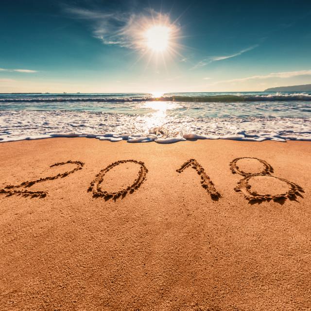 """Happy New Year 2018 concept on the sea beach; sunrsie shot"" stock image"