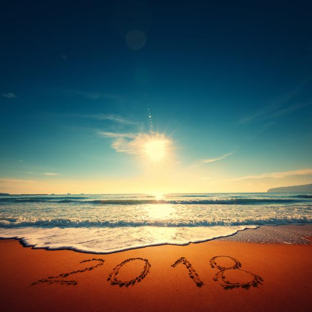 """Beautiful sunrise over the sea. Happy New Year 2018 written on s"" stock image"