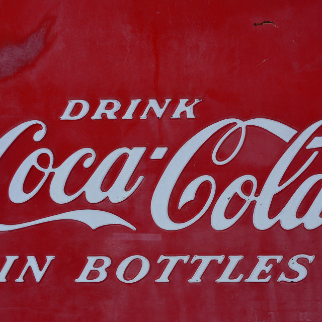 """""""Sign of Coca-Cola painted in a rusty and old metal."""" stock image"""