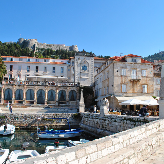 """Old harbour in front of the Loggia, Clock Tower and Spanish Fortress, Hvar Town."" stock image"