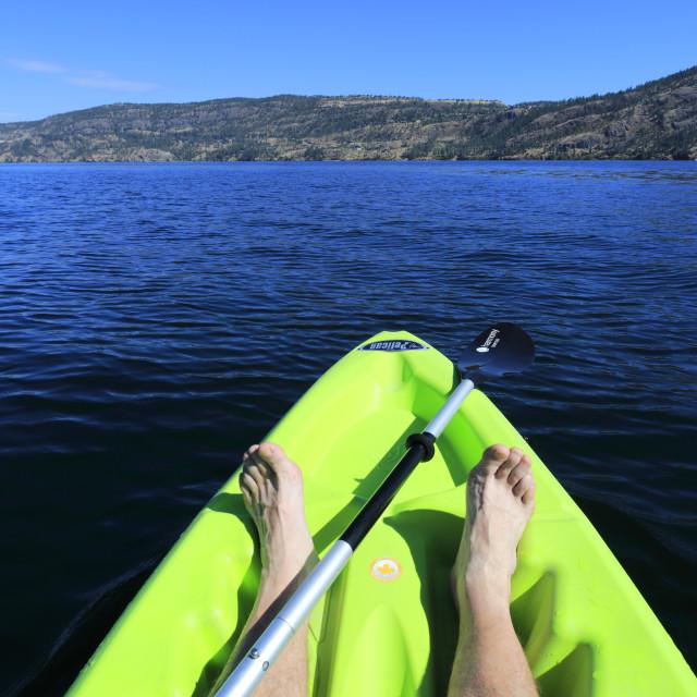 """Canoeist on Lake Okanagan at Bear Creek Park, near Kelowna City, British..."" stock image"