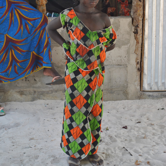 """Beautiful girl poses for the tourist in the street in Carabane-Senegal."" stock image"