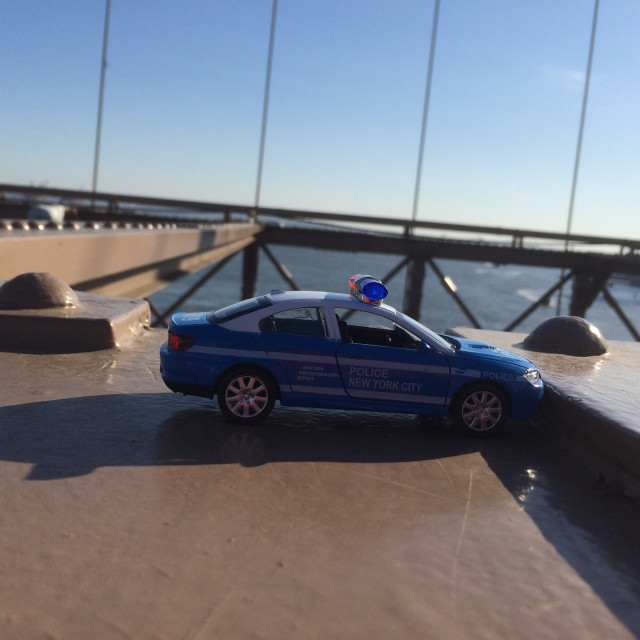 """Policer car miniature at Brooklyn Bridge, NYC, USA."" stock image"