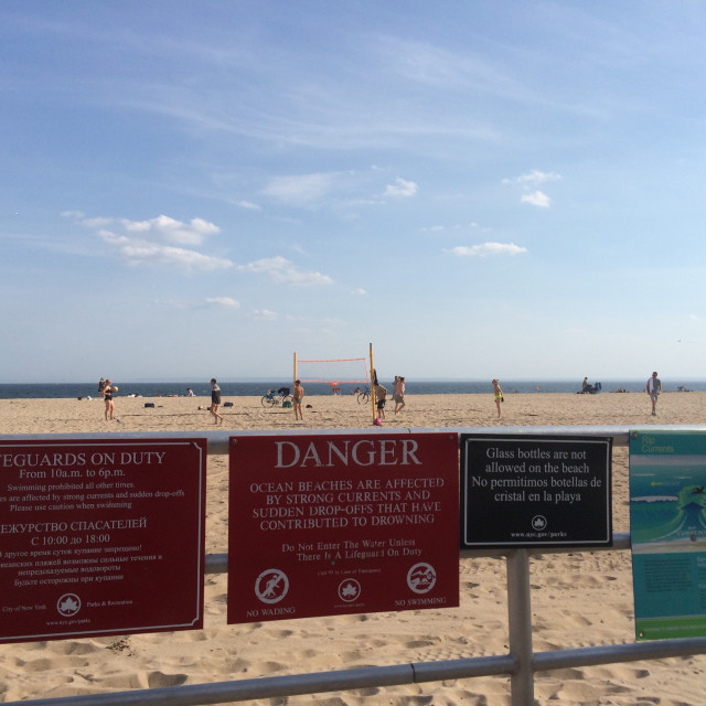 """Signs at Coney Island beach"" stock image"
