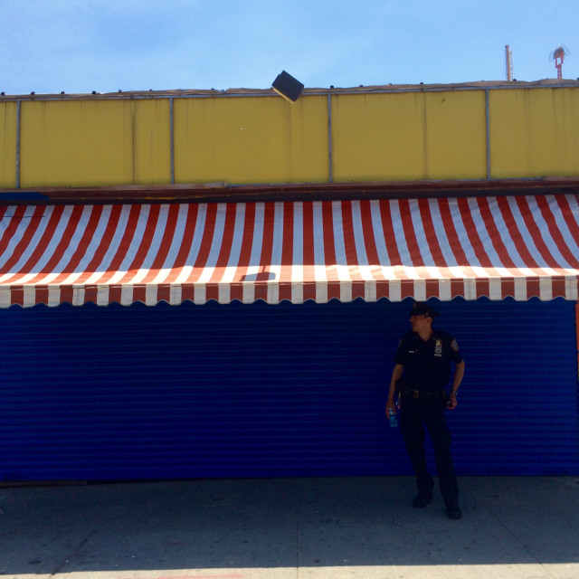 """New York city policeman on patrol in the coney island area of NYC"" stock image"