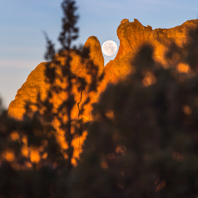 """Super moon Peeks through Smith Rock"" stock image"