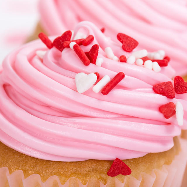 """Closeup of pink Valentines Day cupcake with sprinkles"" stock image"