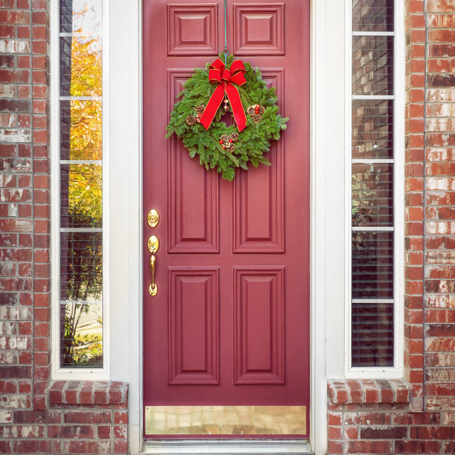 """Balsam Fir Christmas wreath on a red door"" stock image"