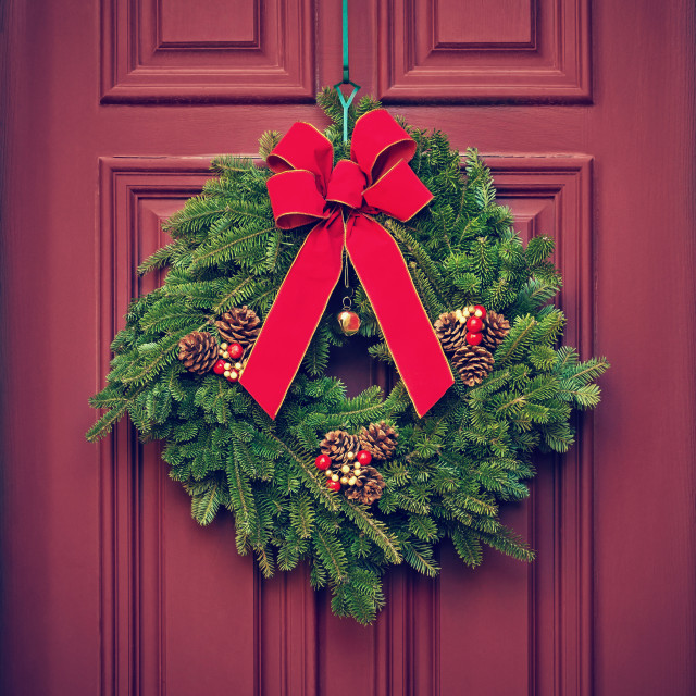 """Christmas wreath on a red wooden door"" stock image"