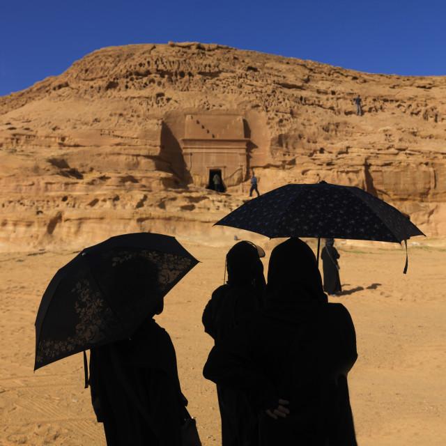 """Tourists in madain saleh archaeologic site, Saudi arabia"" stock image"
