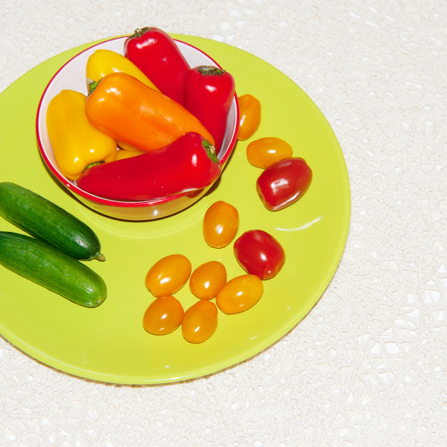 """""""Yellow plate with mix of vivid coloredl vegetables on handmade t"""" stock image"""