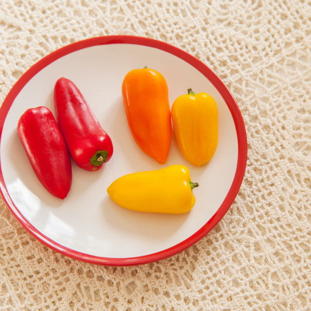 """""""White red plate with colorful sweet paprika on creamy handmade t"""" stock image"""