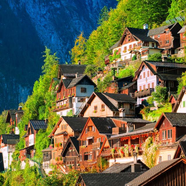 """Traditional wooden houses on the mountain slope in Hallstatt, Austria"" stock image"