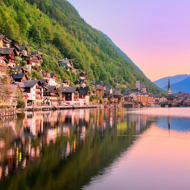 """Hallstatt town reflecting in the lake on sunset, Salzkammergut, Austria"" stock image"