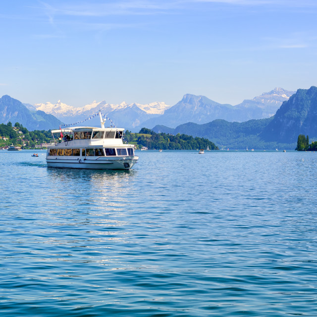 """""""Cruise ship in front of Alps mountains peaks on Lake Lucerne, Switzerland"""" stock image"""