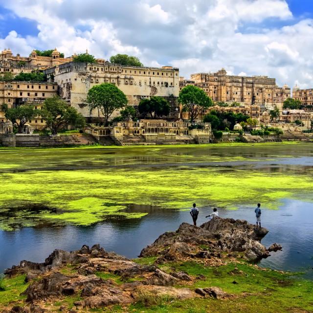 """City Palace in Udaipur rising over Pichola lake, Rajasthan, India"" stock image"
