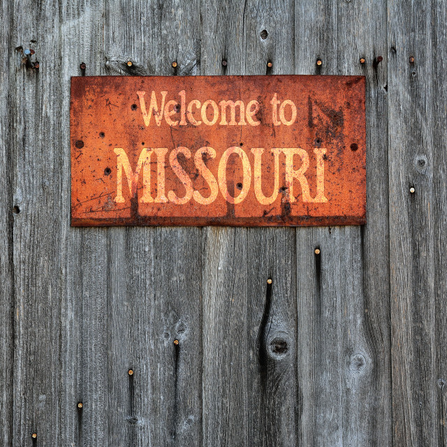 """""""Rusty metal sign with the phrase: Welcome to Missouri."""" stock image"""