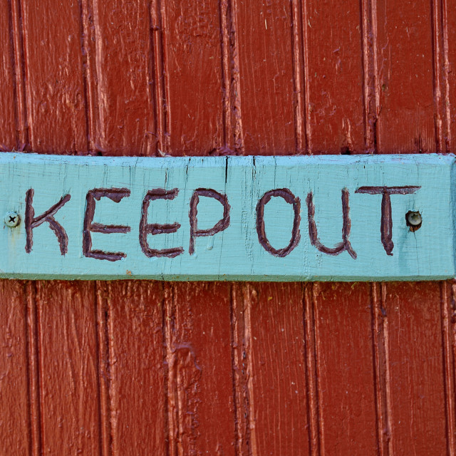 """""""Keep out warning sign over old rustic wooden textured surface."""" stock image"""