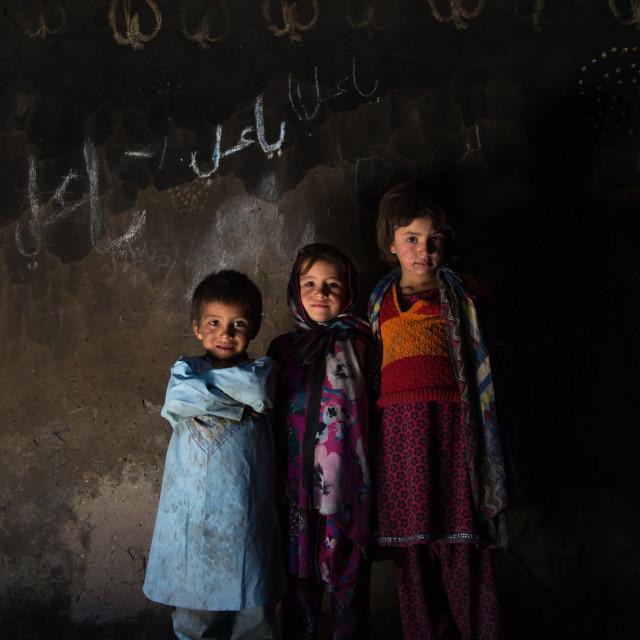 """""""Afghan children in a pamiri house, Badakhshan province, Qazi deh, Afghanistan"""" stock image"""
