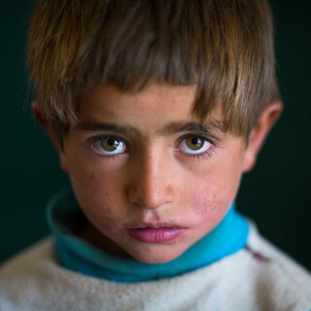 """Portrait of an afghan boy with clear eyes, Badakhshan province, Zebak,..."" stock image"