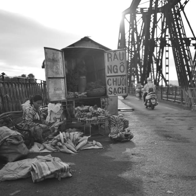 """Seller on Long Bien bridge"" stock image"