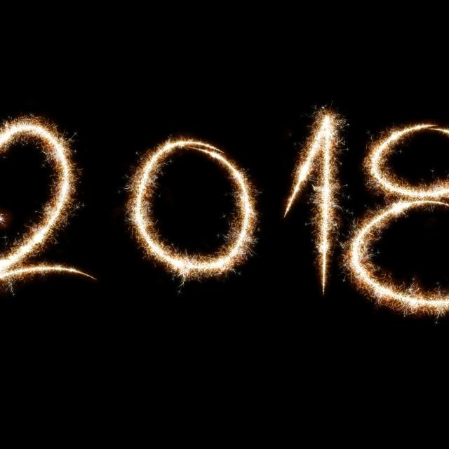"""2018 written with Sparkle firework on black background, happy ne"" stock image"