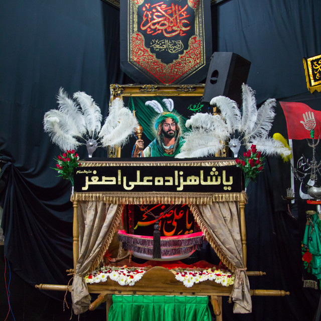 """A craddle in the Hosseinieh of the Mad of Hussein for Muharram to commemorate..."" stock image"