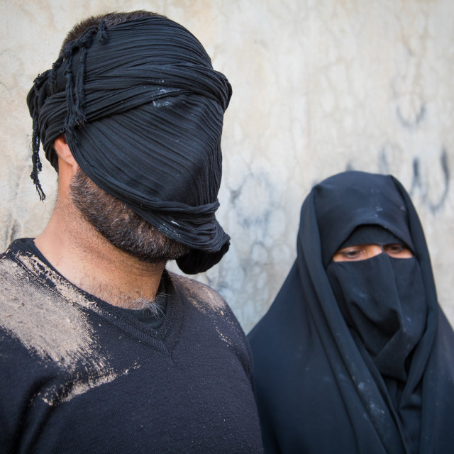 """Portrait of iranian shiite muslim couple with their faces hidden by a veil..."" stock image"