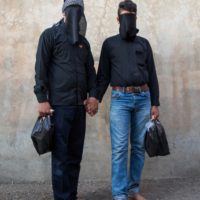 """Portrait of iranian shiite muslim men with their faces hidden by a veil..."" stock image"