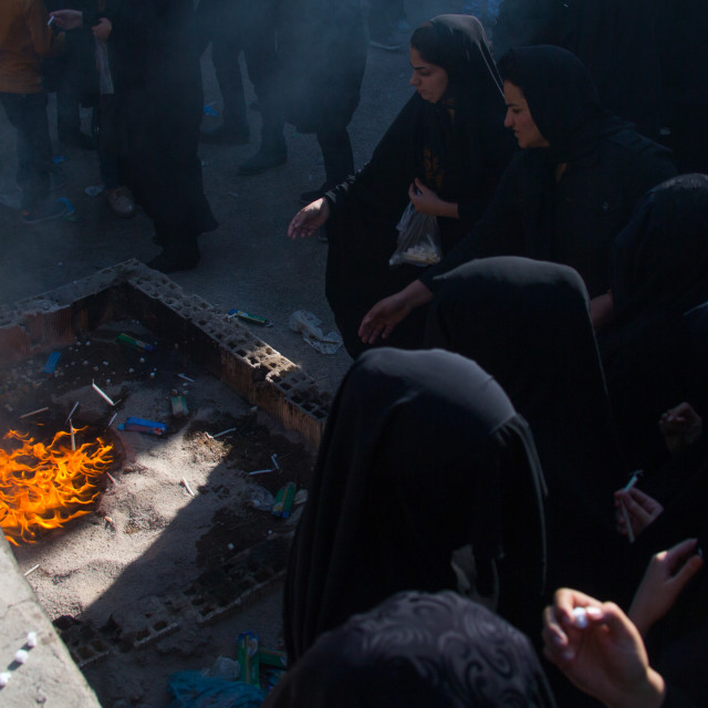 """Iranian women light candles and put sugar cubes during Chehel Manbar festival..."" stock image"