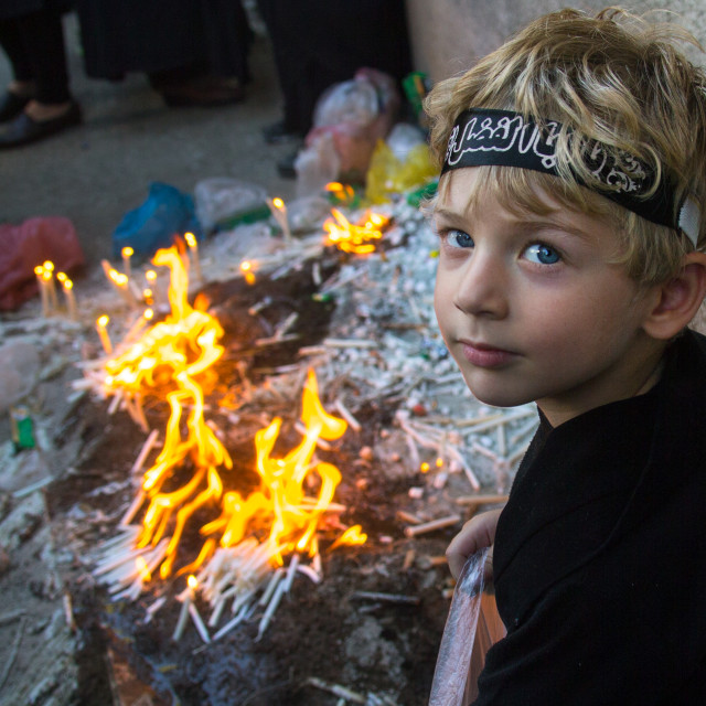 """Iranian boy lights candles during Chehel Manbar ceremony on Tasua to..."" stock image"