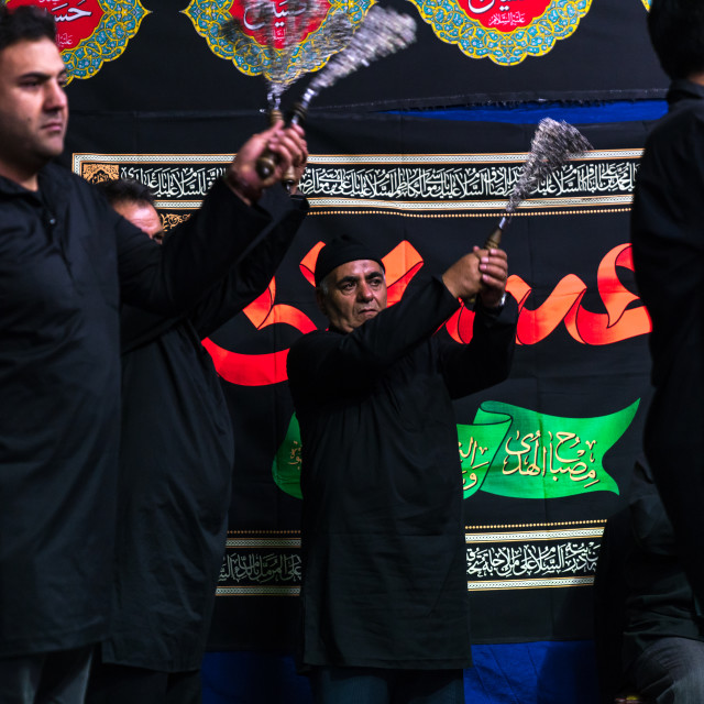 """Iranian shiite muslim men beating themselves with iron chains to commemorate..."" stock image"