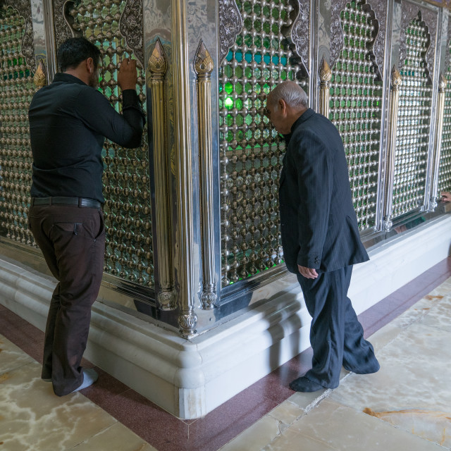 """Men praying in the Shrine of sultan Ali, Kashan County, Mashhad-e Ardahal, Iran"" stock image"