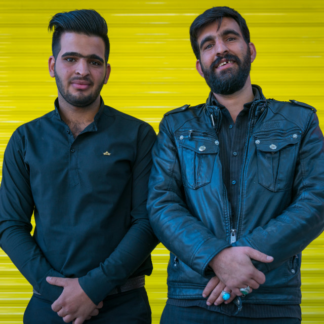 """""""Iranian men in front of a yellow background, Lorestan Province, Khorramabad,..."""" stock image"""