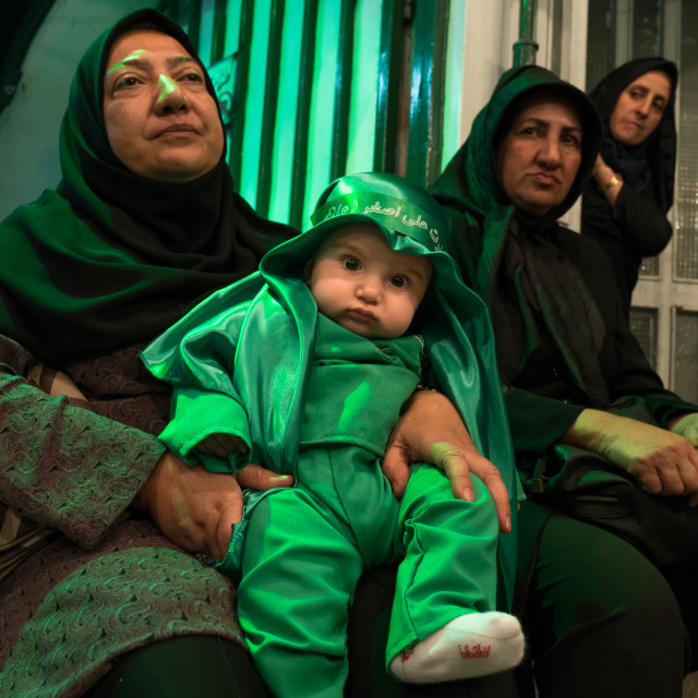 """Iranian shiite muslim mother and her son dressed for Muharram celebration,..."" stock image"