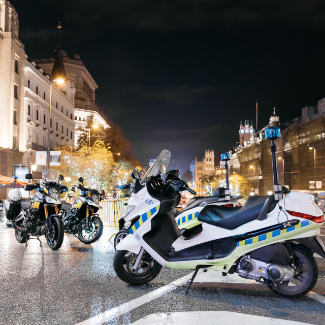"""Police motorbikes in the entrance to Gran Via Street of Madrid a"" stock image"
