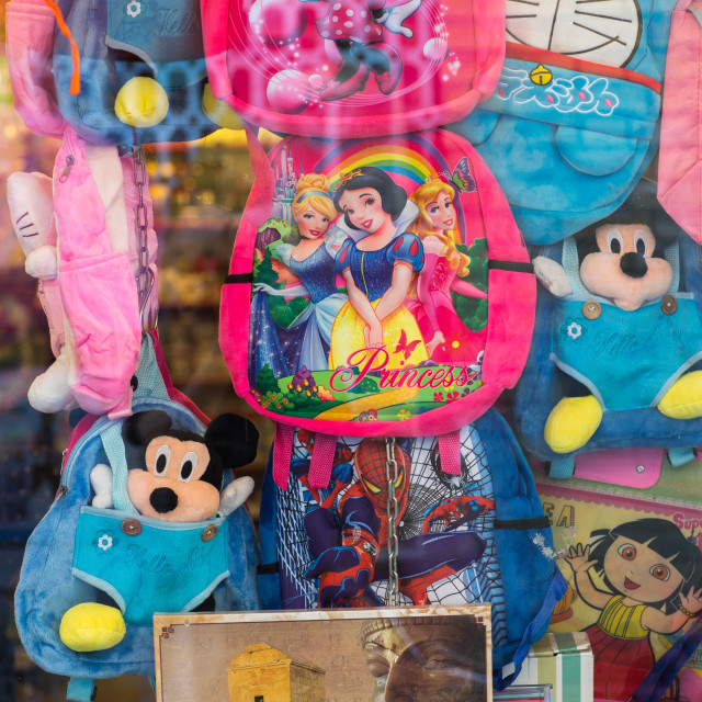 """walt disney bags mixed and persian poster in a shop, Hormozgan, Bandar Abbas,..."" stock image"
