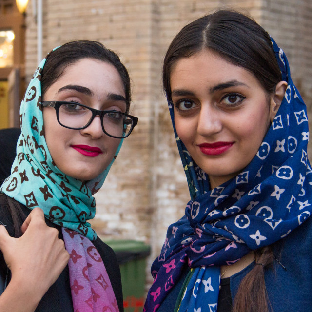 """""""iranian young women with louis vuitton scarves, Central district, Tehran, Iran"""" stock image"""