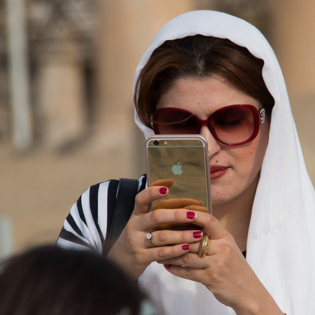 """""""iranian woman taking pictures with an iphone, Central district, Tehran, Iran"""" stock image"""