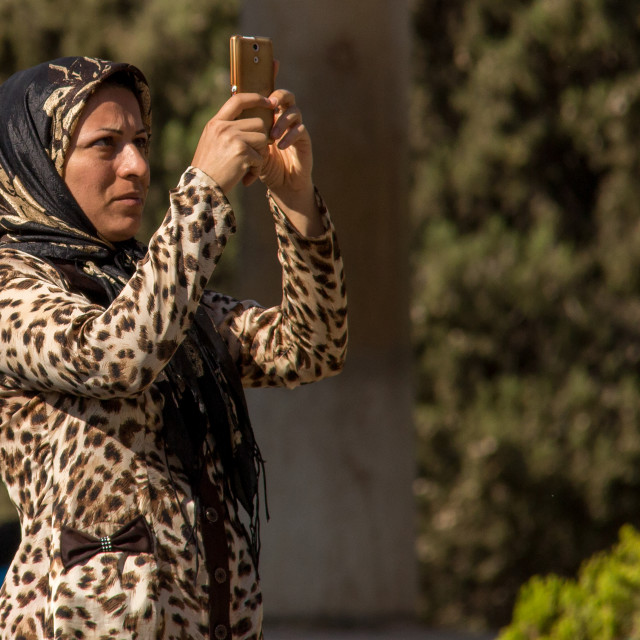 """""""iranian woman taking pictures with a mobile phone, Central district, Tehran,..."""" stock image"""