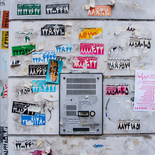 """""""doorway full of advertising stickers, Central district, Tehran, Iran"""" stock image"""