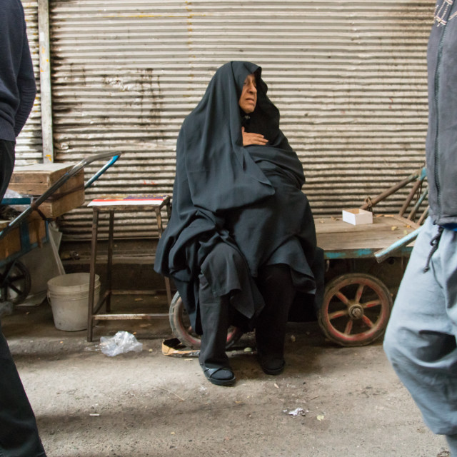 """""""old woman sitting on a bench in the bazaar, Central district, Tehran, Iran"""" stock image"""