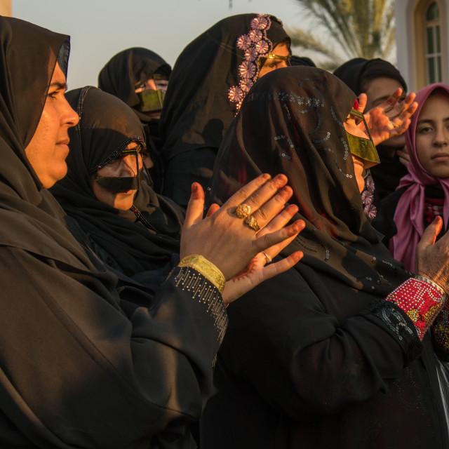 """""""women wearing burqas masks during a wedding, Hormozgan, Kushkenar, Iran"""" stock image"""